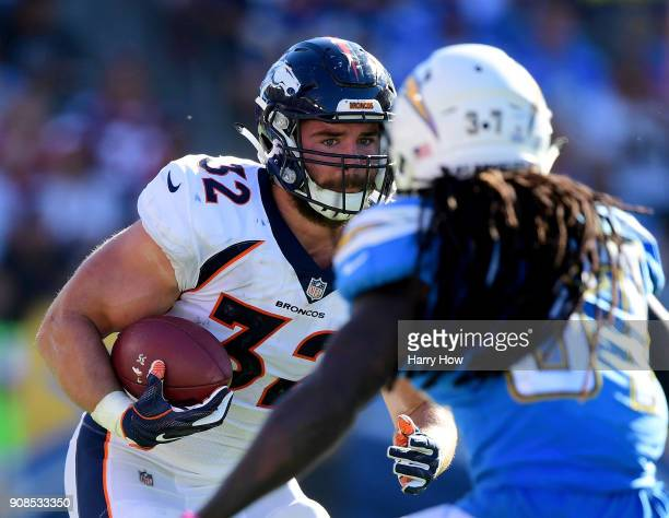 Andy Janovich of the Denver Broncos runs after his catch in front of Jahleel Addae of the Los Angeles Chargers at StubHub Center on October 22 2017...