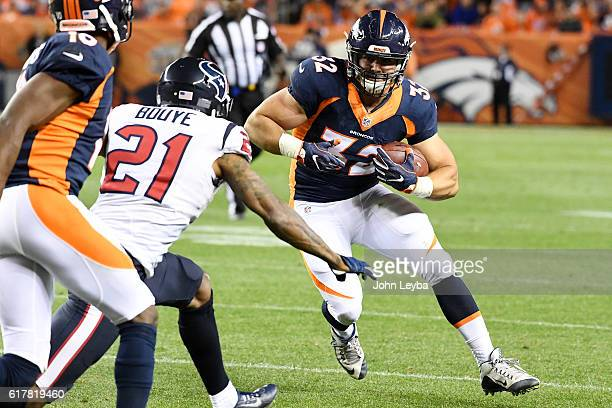Andy Janovich of the Denver Broncos runs as AJ Bouye of the Houston Texans closes in during the second quarter on Monday October 24 2016 The Denver...