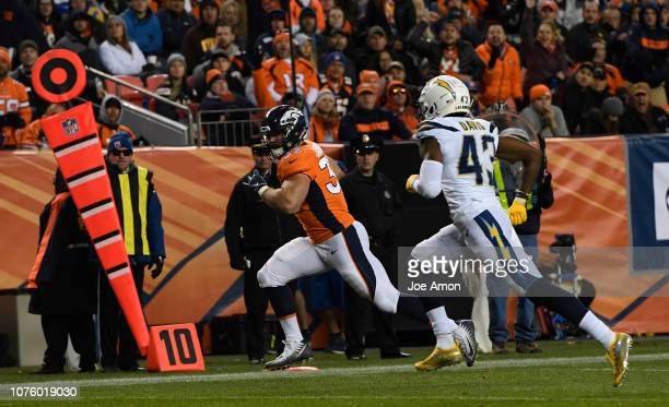 Andy Janovich of the Denver Broncos scores a touchdown after a catch during the third quarter against the Los Angeles Chargers The Denver Broncos...