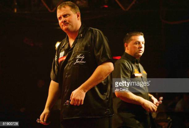 Andy Jenkins and rival Peter Evison are pictured during their match at the 2005 Ladbrokescom World Darts Championship at The Circus Tavern on...