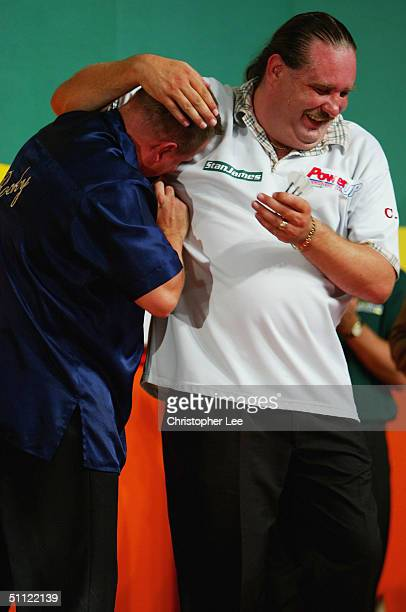 Andy Jenkins is congratulated by Dennis Smith after he beats him in the Second Round during the Stan James World Matchplay Darts Championship at the...