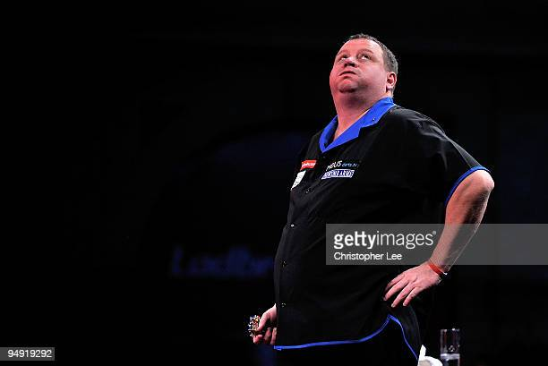 Andy Jenkins of England blows out his cheeks as he plays against Peter Manley of England during the 2010 Ladbrokescom World Darts Championship Round...
