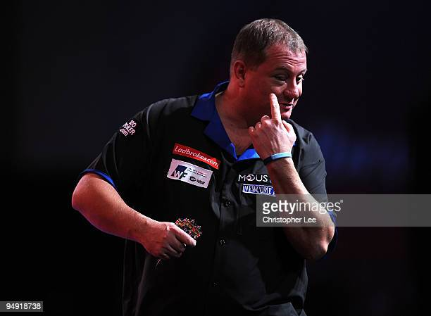 Andy Jenkins of England points out his black eye as he plays against Peter Manley of England during the 2010 Ladbrokescom World Darts Championship...