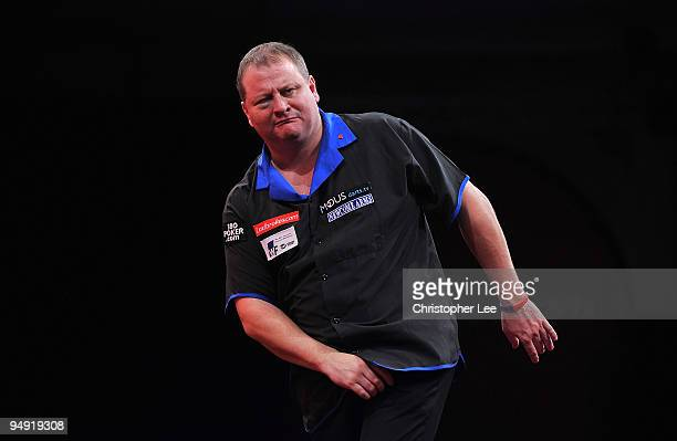Andy Jenkins of England pulls a face after he misses a chance as he plays against Peter Manley of England during the 2010 Ladbrokescom World Darts...