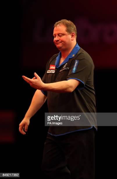 Andy Jenkins reacts on his way to defeat during the Ladbrokescom World Darts Championship at Alexandra Palace London