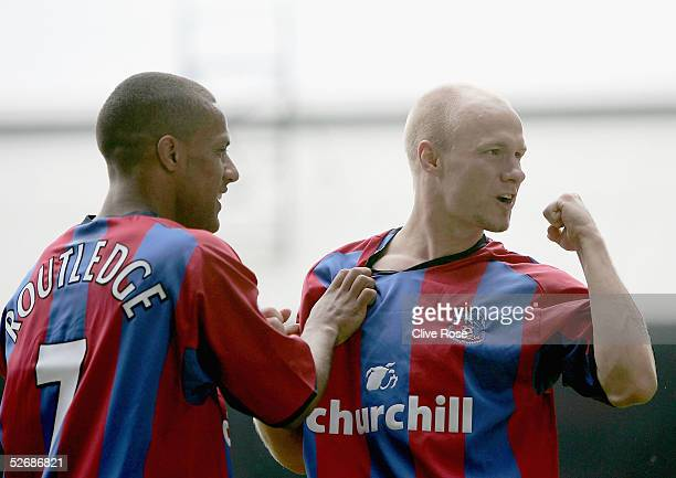 Andy Johnson celebrates with Wayne Routledge of Palace after Johnson scores the opening goal during the Barclays Premiership match between Crystal...