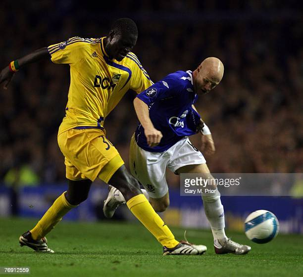 Andy Johnson of Everton and Papa Gueye of Metalist Kharkiv in action during the UEFA Cup match between Everton and Metalist Kharkiv at Goodison Park...