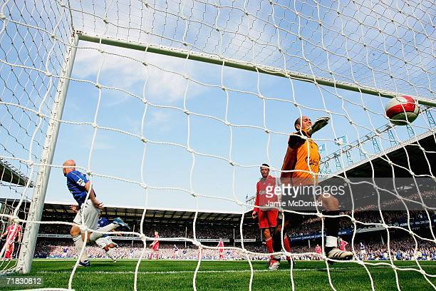 Andy Johnson of Everton scores his team's third goal past goalkeeper Jose Reina of Liverpool during the Barclays Premiership match between Everton...