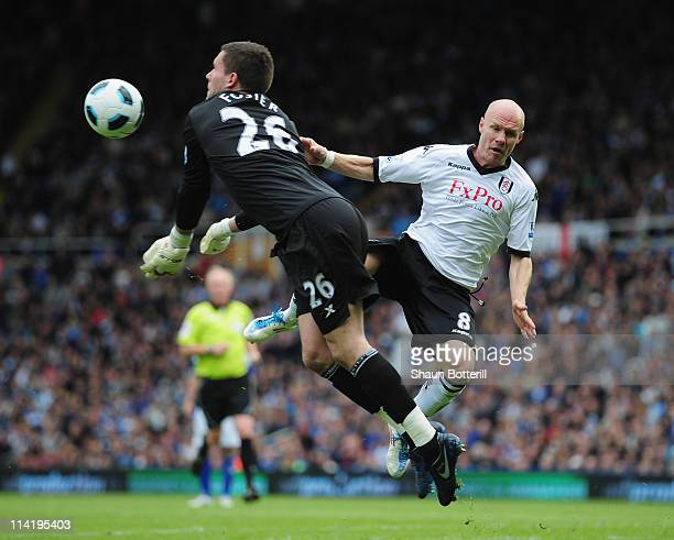 Andy Johnson of Fulham challenges Ben Foster of Birmingham City during the Barclays Premier League match between Birmingham City and Fulham at St...