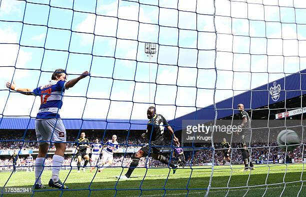 Andy Johnson of Queens Park Rangers beats Kamil Zayatte of Sheffield Wednesday to score his goal during the Sky Bet Championship match between Queens...