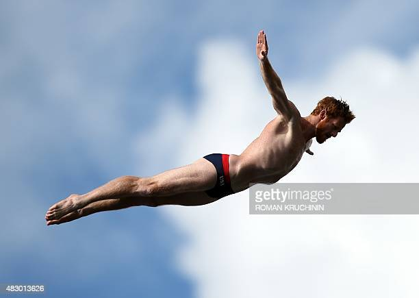 US Andy Jones competes in the Men's 27m High Diving final during the 16th FINA World Championships at the Kanzanka River on August 5 2015 in Kazan...