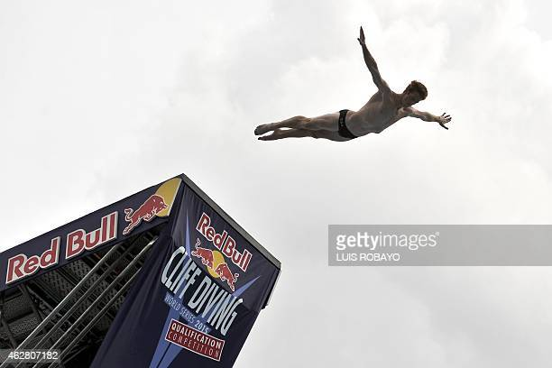 US Andy Jones dives from the 27meterhigh platform during the Red Bull Qualifier Cliff Diving World Series 2015 at the Pools Hernando Botero O'Byrne...