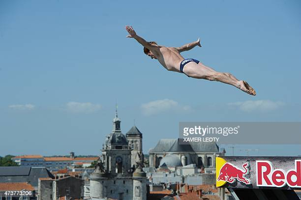 US Andy Jones jumps from 27 meter Saint Nicolas tower in La Rochelle western France during La Rochelle's cliff diving 2015 World Series competition...