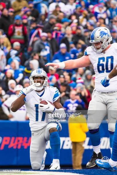 Andy Jones of the Detroit Lions celebrates a touchdown reception during the second quarter against the Buffalo Bills at New Era Field on December 16...