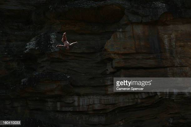 Andy Jones of the United States competes during the Red Bull Cliff Diving qualifying round in the Hawkesbury River on January 31 2013 in Sydney...