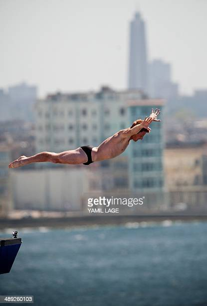 Andy Jones of the USA dives from a 27meterhigh platform during the Red Bull Cliff Diving World Series 2014 at the Morro Castle in Havana on May 10...
