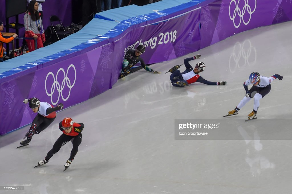 Andy Jung (AUS) slides hard into the barrier as Thibaut Fauconnet (FRA) follows close behind during the Men's 500M Heat 1 race during the 2018 Winter Olympic Games at the Gangneung Ice Arena on February 20, 2018 in PyeongChang, South Korea.