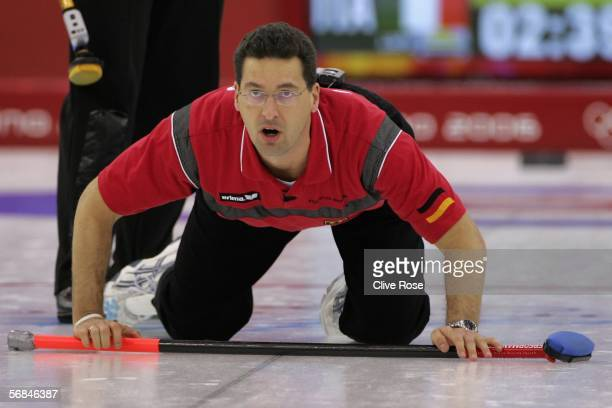 Andy Kapp of Germany looks on as he plays a bad shot during the preliminary round of the Men's curling between Germany and Italy during Day 4 of the...