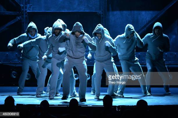 "Andy Karl and the cast of ""Rocky"" perform onstage during the 68th Annual Tony Awards at Radio City Music Hall on June 8 2014 in New York City"