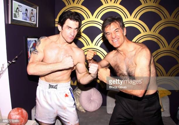 Andy Karl as Rocky Balboa and Dr Mehmet Oz pose backstage at the hit musical Rocky on Broadway at The Winter Garden Theater on April 25 2014 in New...