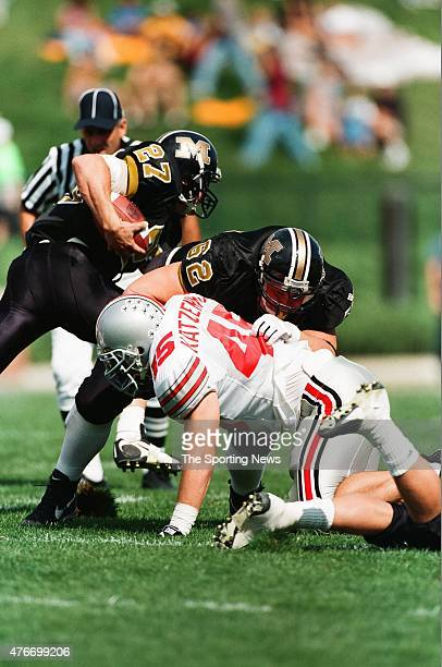 Andy Katzenmoyer of the Ohio State Buckeyes makes a tackle against the Missouri Tigers on September 27 1997
