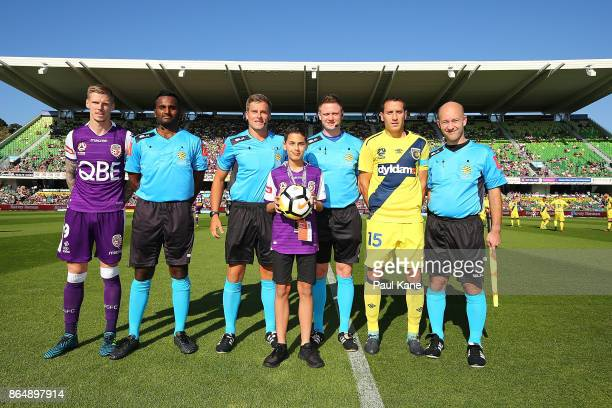 Andy Keogh of the Glory and Alan Baro of the Mariners line up with match officials and the ball kid prior to the round three ALeague match between...