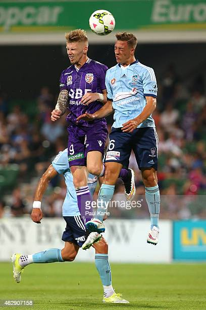 Andy Keogh of the Glory and Alexander Gersbach of Sydney contest a header during the round 16 ALeague match between the Perth Glory and Sydney FC at...