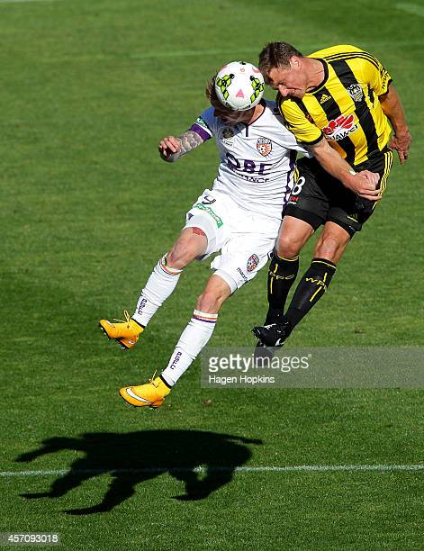 Andy Keogh of the Glory and Ben Sigmund of the Phoenix compete for a header during the round one A-League match between Wellington Phoenix and Perth...
