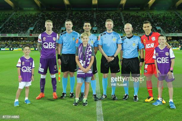 Andy Keogh of the Glory and Isaias of the Reds line up with match officials and mascots before the round five ALeague match between the Perth Glory...