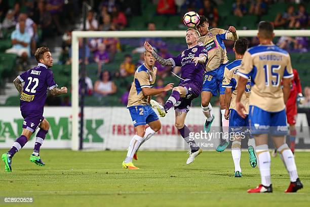 Andy Keogh of the Glory and Johnny Koutroumbis of the Jets contest a header during the round 10 ALeague match between the Perth Glory and the...