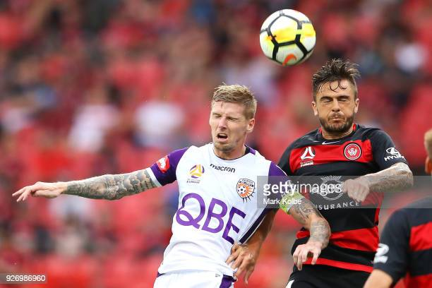 Andy Keogh of the Glory and Josh Risdon of the Wanderers compete for the ball during the round 23 ALeague match between the Western Sydney Wanderers...