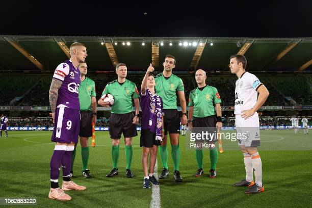Andy Keogh of the Glory and Matthew McKay of the Roar attend the coin toss during the round three ALeague match between the Perth Glory and the...