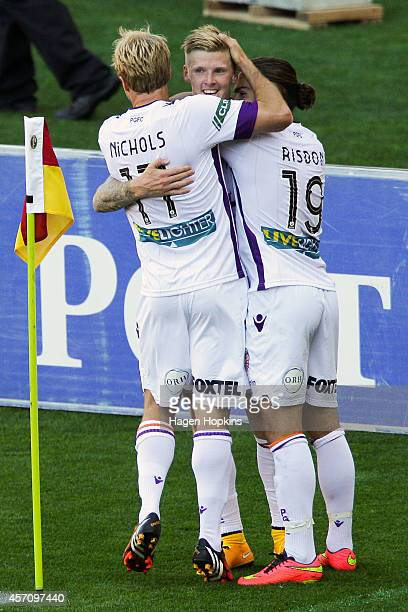 Andy Keogh of the Glory celebrates his goal with teammates Mitch Nichols and Joshua Risdon during the round one ALeague match between Wellington...