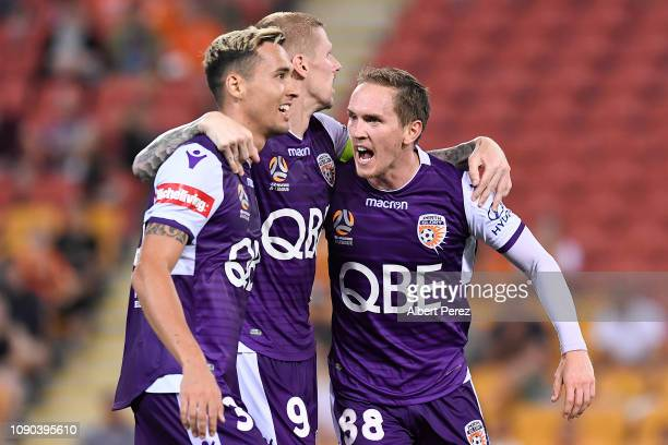 Andy Keogh of the Glory celebrates with team mates after scoring his team's fourth goal during the round 11 ALeague match between the Brisbane Roar...