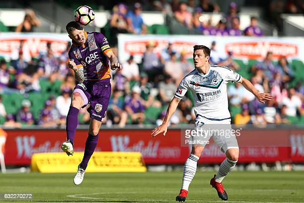 Andy Keogh of the Glory heads the ball against James Donachie of the Victory during the round 16 ALeague match between Perth Glory and Melbourne...