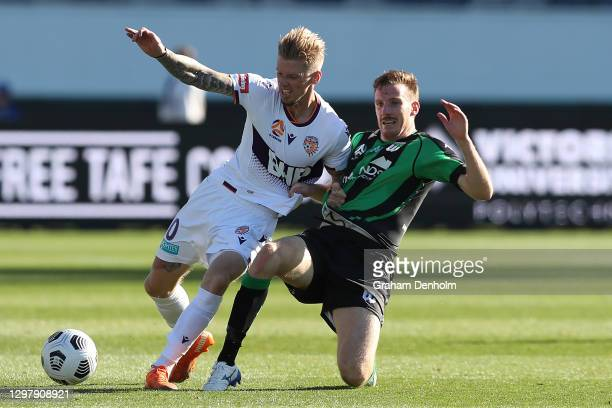 Andy Keogh of the Glory is tackled by Aaron Calver of Western United during the A-League match between Western United and the Perth Glory at GMHBA...