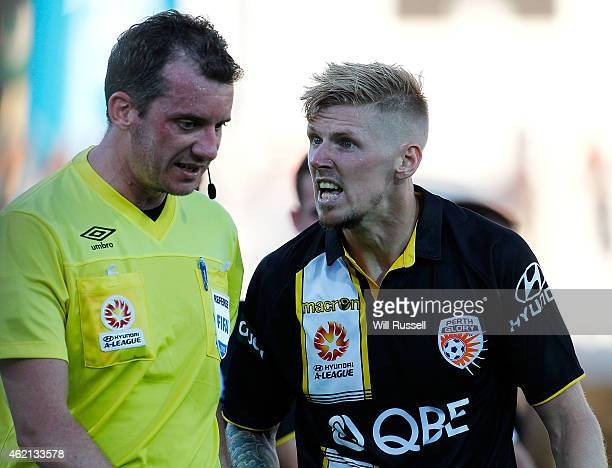 Andy Keogh of the Glory speaks to match referee Peter Green during the round 16 ALeague match between Perth Glory and Melbourne Victory at nib...
