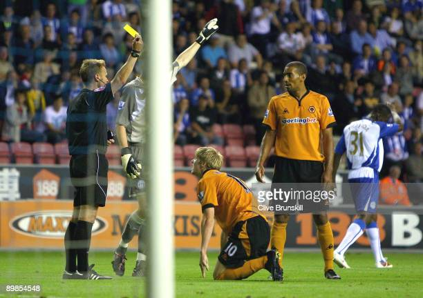 Andy Keogh of Wolverhampton Wanderers is fouled in the penalty area by Titus Bramble of Wigan Athletic only to receive a yellow card during the...