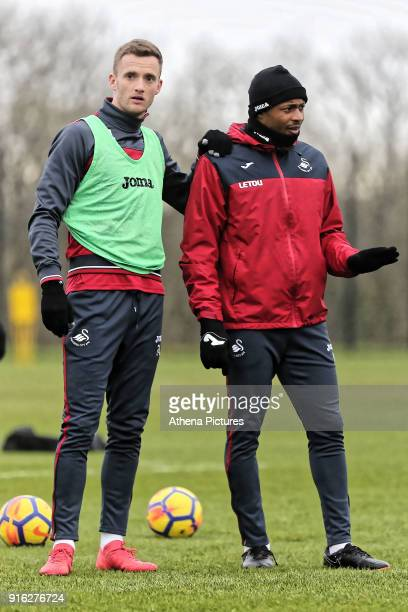 Andy King and Andre Ayew chat during the Swansea City Training and Press Conference at The Fairwood Training Ground on February 08 2017 in Swansea...