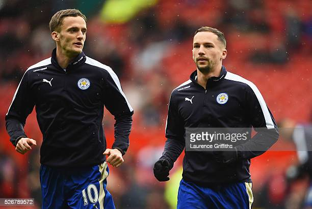 Andy King and Danny Drinkwater of Leicester City warm up prior to the Barclays Premier League match between Manchester United and Leicester City at...
