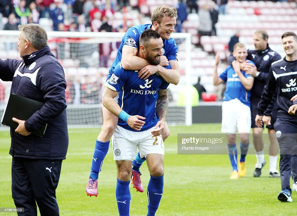 Andy King and Marcin Wasilewski of Leicester City celebrate their premier league survival after the Premier league match between Sunderland and Leicester City at The Stadium of Light on May 16, 2015 in Sunderland, England.