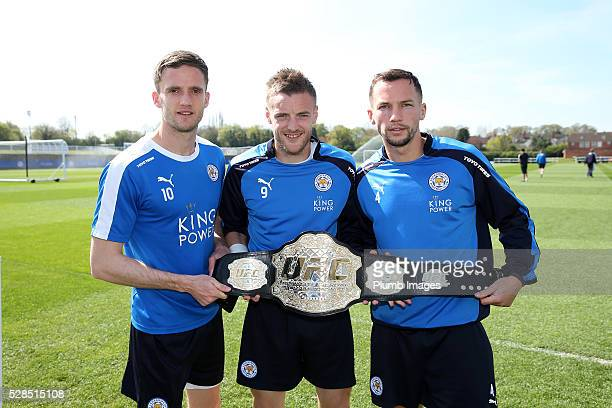 Andy King Jamie Vardy and Danny Drinkwater of Leicester City Pose's With a Special UFC Belt during the Leicester City training session at Belvoir...