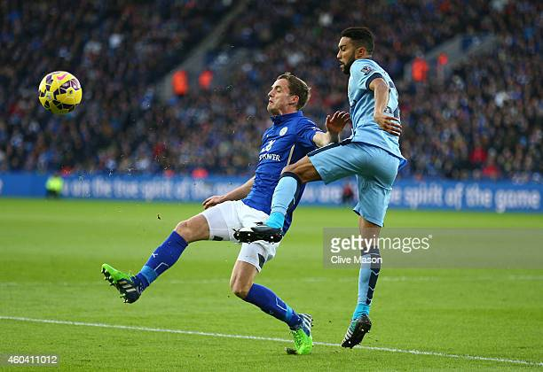 Andy King of Leicester City and Gael Clichy of Manchester City compete for the ball during the Barclays Premier League match between Leicester City...