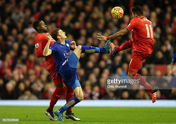 Andy King of Leicester City battles for the ball with Divock Origi of Liverpool and Roberto Firmino of Liverpool during the Barclays Premier League...