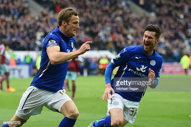 Andy King of Leicester City celebrates scoring their second goal with David Nugent during the Barclays Premier league match Leicester City and West...