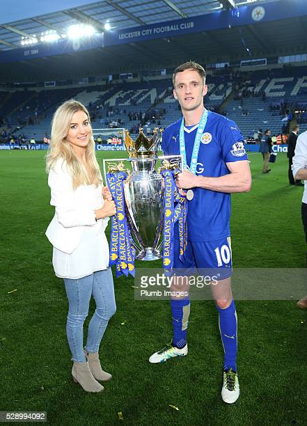 Andy King of Leicester City celebrates with the Premier League trophy after the Barclays Premier League match between Leicester City and Everton at...