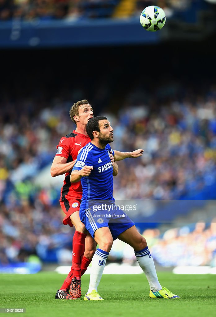 Andy King of Leicester City closes down Cesc Fabregas of Chelsea during the Barclays Premier League match between Chelsea and Leicester City at Stamford Bridge on August 23, 2014 in London, England.