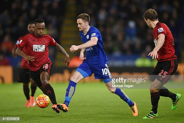 Andy King of Leicester City controls the ball against Saido Berahino and Craig Dawson of West Bromwich Albion during the Barclays Premier League...