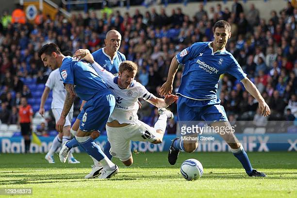 Andy King of Leicester City falls under a challenge from Liam Ridgewell and Pablo Ibanez of Birmingham City but fails to be awarded a penalty during...