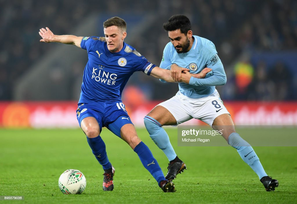 Andy King of Leicester City holds off Ilkay Gundogan of Manchester City during the Carabao Cup Quarter-Final match between Leicester City and Manchester City at The King Power Stadium on December 19, 2017 in Leicester, England.